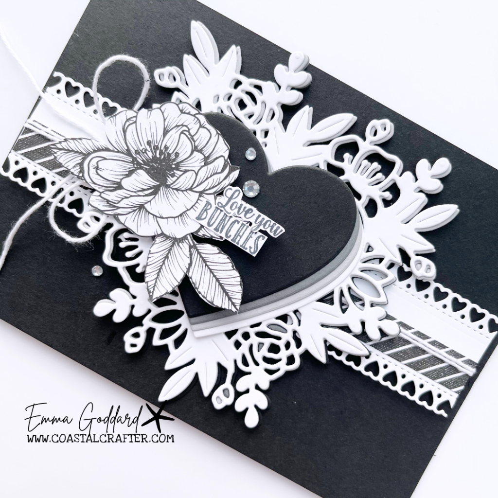 Close up of the black and white love themed card. Using the Floral Heart Dies with the larger sketched flower